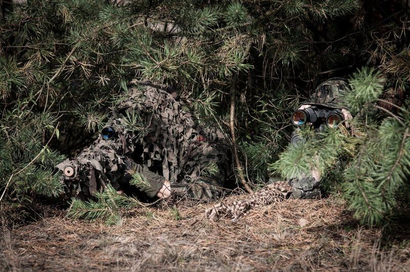 snipers hiding in the bush ready to shoot